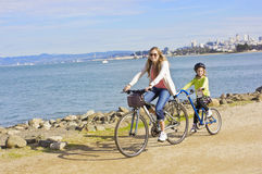 Mother and Daughter biking along the beach in San Francisco Royalty Free Stock Photography