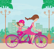 Mother and daughter biking Royalty Free Stock Photos