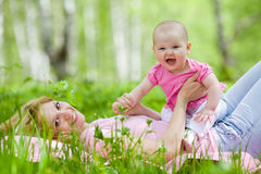 Mother and daughter in birch spring park. Mother and daughter in birch spring or summer park Royalty Free Stock Photo