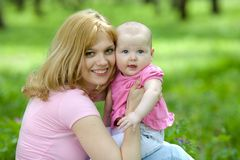 Mother and daughter in birch spring park Royalty Free Stock Photos