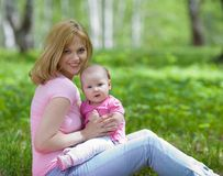 Mother and daughter in birch spring park Royalty Free Stock Photography