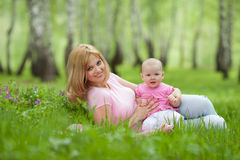 Mother and daughter in birch spring park Stock Image