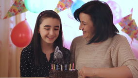 Mother and daughter with birthday cake stock video footage