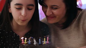 Mother and daughter with birthday cake stock footage