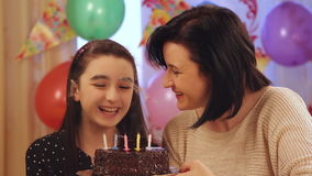 Mother and daughter with birthday cake stock video