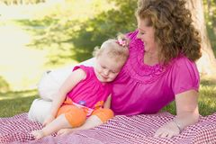 Mother and Daughter on Blanket in the Park Royalty Free Stock Image