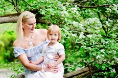 Mother and daughter in blooming garden Royalty Free Stock Photography