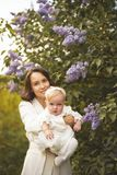 Mother and daughter in blossoming park royalty free stock image
