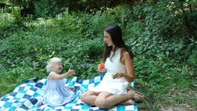 Mother and daughter blow bubbles stock video footage