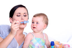 Mother and daughter blowing bubbles Royalty Free Stock Photo