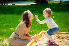 Mother and daughter blowing soup bubbles Stock Image