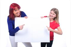 Mother with a daughter and a board Stock Photography