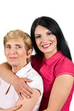 Mother and daughter bonding. Portrait of mother and her adult daughter bonding isolated on white background,you can watch also in this collection series royalty free stock image