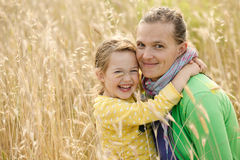 Mother and daughter bonding embrace Stock Photos