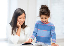 Mother and daughter with book Royalty Free Stock Images