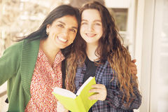 Mother and daughter with books Royalty Free Stock Images