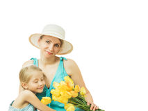 The mother and daughter and a bouquet of yellow tulips isolated on white background. Stock Image