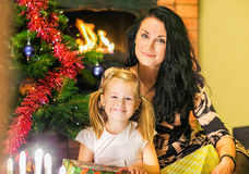 Mother with a daughter. Boxes of gifts on the background of the Stock Photo