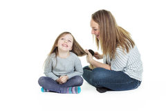 Mother Daughter brush hair Royalty Free Stock Photography