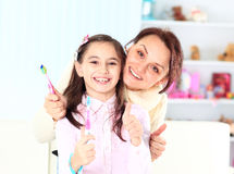 Daughter brush their teeth. Royalty Free Stock Photo