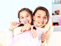 Daughter brush their teeth. Royalty Free Stock Image