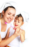 Mother and daughter brushing teeth Stock Photography