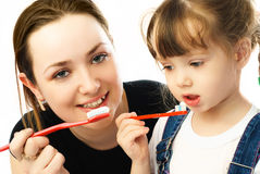Mother and daughter brushing teeth Stock Image