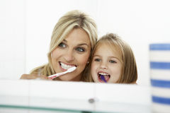 Mother And Daughter Brushing Teeth Together Stock Photos