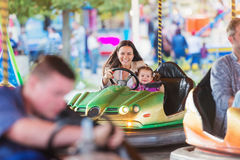Mother and daughter in bumper car at fun fair Stock Photography