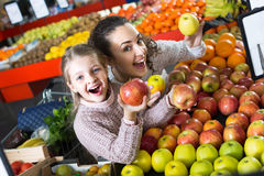 Mother and daughter buying apples Stock Image