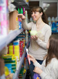 Mother and daughter buying bath sponges Stock Images