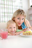 Mother with a daughter in cafe Stock Photography