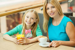 Mother and daughter in cafe. Stock Photo