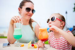 Mother and daughter at cafe royalty free stock photography