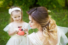Mother and daughter with a cake Stock Image