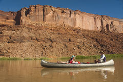 Mother and daughter in canoes on desert river Stock Photo