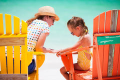 Mother and daughter at Caribbean beach Royalty Free Stock Photography