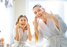 Mother and daughter caring for skin royalty free stock photo