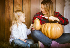Mother and daughter carving pumpkins Royalty Free Stock Images