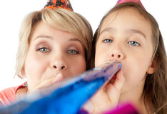 Mother and daughter celebrating Stock Photo