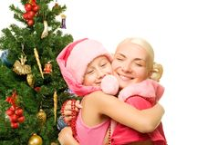 Mother and daughter celebrating christmas Royalty Free Stock Photos