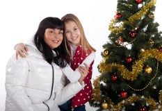 Mother and daughter celebrating christmas Royalty Free Stock Photography