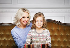 Mother and daughter celebrating Christmas at home Royalty Free Stock Images