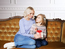 Mother and daughter celebrating Christmas at home Stock Photo
