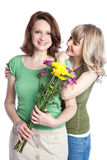 Mother and daughter celebrating mother's day. A portrait of a happy mother and daughter celebrating mother's day Royalty Free Stock Photo