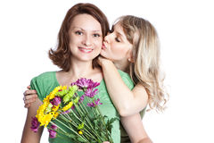 Mother and daughter celebrating mother's day. A portrait of a happy mother and daughter celebrating mother's day Royalty Free Stock Images