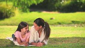 Mother and daughter chatting outdoors Royalty Free Stock Image