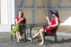 Mother and daughter chatting in the terrace Royalty Free Stock Images