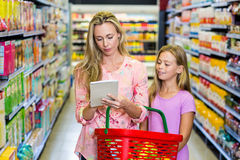 Mother and daughter checking list Stock Photo