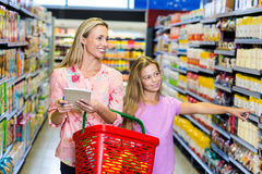 Mother and daughter checking list Royalty Free Stock Image